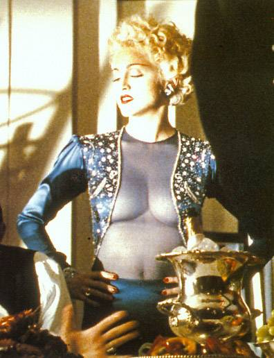 It doesn't help matters any that Madonna is dressed like this.
