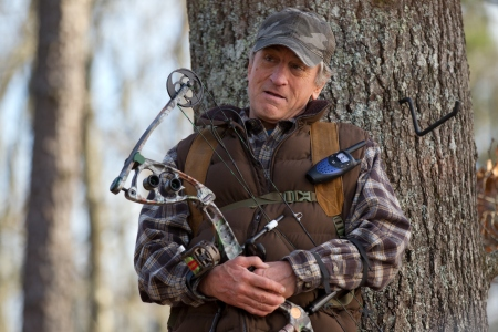 Hunting cap, compound bow, flannel...yeah all the ingredients for an action film